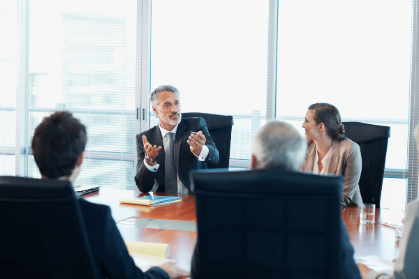 Strong leader leading discussion in conference room