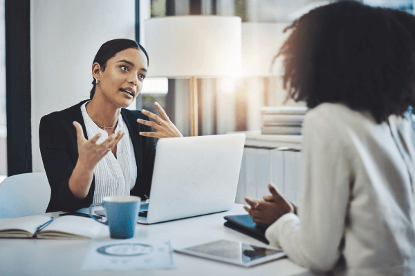 Strong leader giving employee feedback during a one-on-one meeting at work