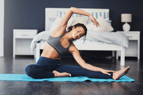 Woman doing yoga during relaxing morning routine at home