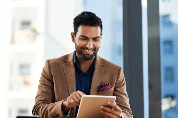 Successful mortgage leader reading plans on notepad