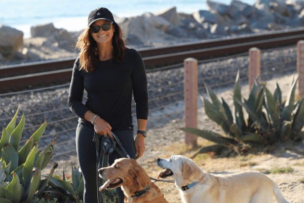 Building Champions Executive Coach Wendi Kroll walking her dogs in California
